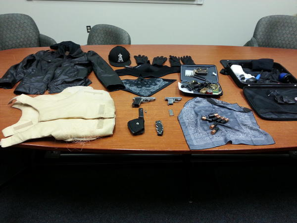 Weapons, ammunition and other items recovered from suspected carjackers on Wednesday in Lancaster.