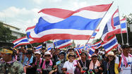 Thai premier survives no-confidence vote, but protests continue