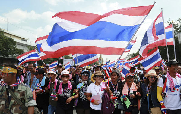 Anti-government protesters march to the Defense Ministry in Bangkok, Thailand, on Thursday.