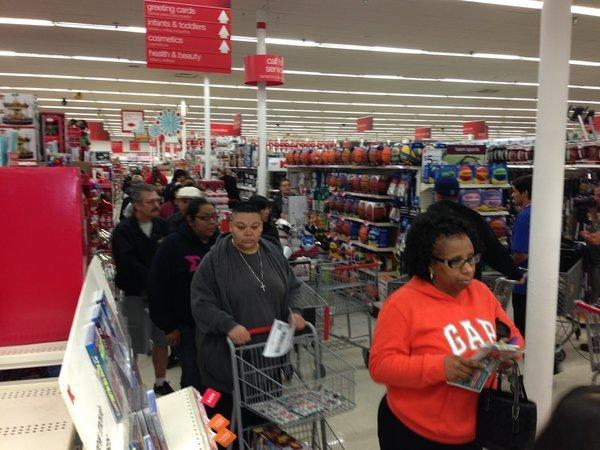 Shoppers wait in line for electronics at a Kmart store in Burbank early Thanksgiving morning. (Tiffany Hsu / Los Angeles Times / November 28, 2013)