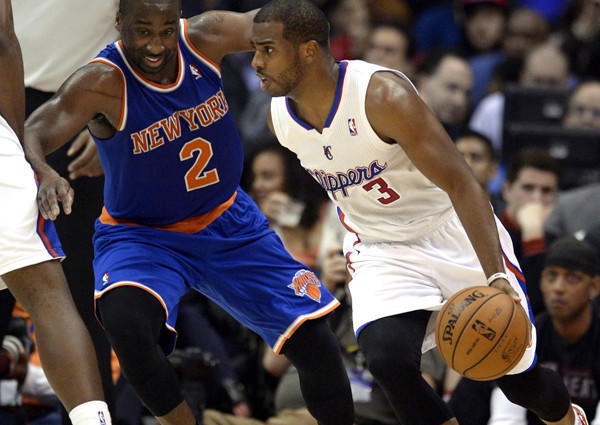 Clippers point guard Chris Paul drives against Knicks point guard Raymond Felton in the second half of their game Wednesday night in New York.
