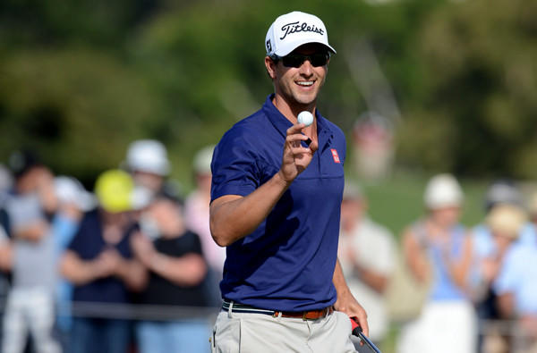 Adam Scott acknowledges the crowd after making a putt during the first round of the Australian Open on Thursday at the Royal Sydney Golf Club in Sydney.
