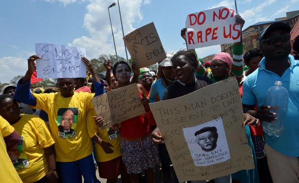 On Oct. 18, South African protesters rally in Diepsloot, north of Johannesburg, after five people were arrested in connection with the alleged rape and murder of two toddlers in a shantytown.