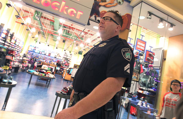 Newport News Master Police Officer Joe Voboril pulls extra duty patrolling Patrick Henry Mall Tuesday evening. The mall hires off-duty police officers to augment the private security already in place.