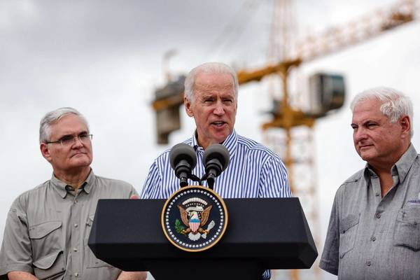 Vice President Joe Biden speaks next to Panamanian President Ricardo Martinelli, right, and Panama Canal Authority CEO Jorge Quijano during a visit to the construction site of the Panama Canal expansion project.