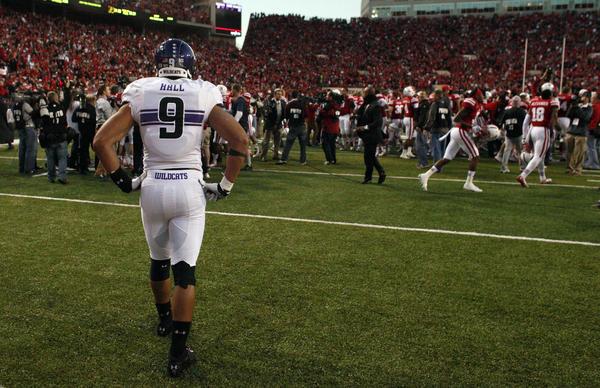 Northwestern safety Jimmy Hall watches the Cornhuskers celebrate after winning the game on the last play of the game at Memorial Stadium. Nebraska won 27-24.