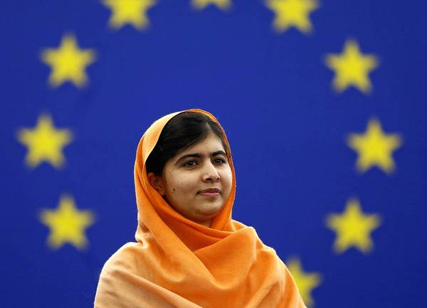 Pakistani activist Malala Yousafzai, 16, who was shot by the Taliban for campaigning for girls' education, attends an award ceremony to receive her 2013 Sakharov Prize at the European Parliament in Strasbourg on Nov. 20.