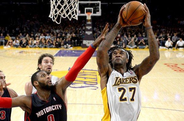 Lakers power forward Jordan Hill (27) tries to score inside against Pistons center Andre Drummond during a game at Staples Center.
