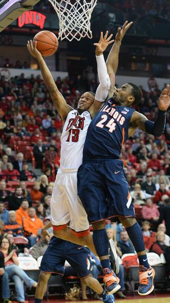 Bryce Dejean-Jones UNLV drives to the basket against Rayvonte Rice of Illini.