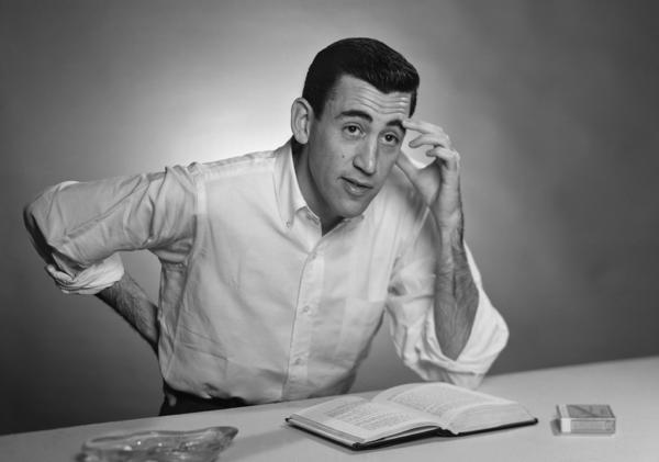 "Author J.D. Salinger poses for a portrait as he reads from his classic American novel ""The Catcher in the Rye"" on November 20, 1952 in Brooklyn."