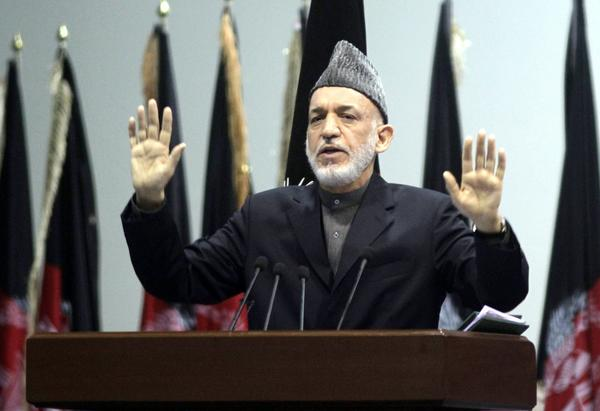 Afghan President Hamid Karzai, shown speaking in Kabul on Sunday during the close of the loya jirga, or grand assembly, accused Western forces Thursday of carrying out a drone strike that killed at least one civilian.
