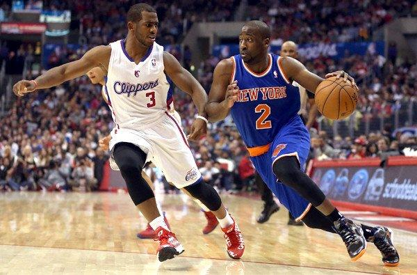 Clippers point guard Chris Paul tries to cut off a drive by Knicks point guard Raymond Felton in the first half of their game on Wednesday at Staples Center.