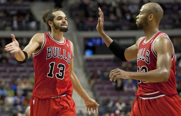 Joakim Noah,left, and Taj Gibson celebrate during the fourth quarter Wednesday against the Pistons.