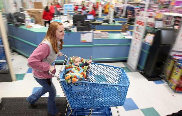 Mandelin Hoover and her son Xander head into Toys-R-Us to snag some Thanksgiving Day deals as the store opens at 5:00 P.M. Thursday.