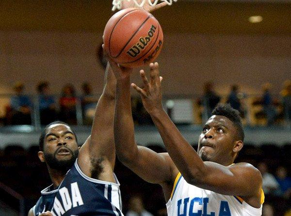 Bruins guard Jordan Adams is fouled by Nevada forward Ronnie Stevens Jr. during their game at the Continental Tire Las Vegas Invitational on Thursday at the Orleans Arena.