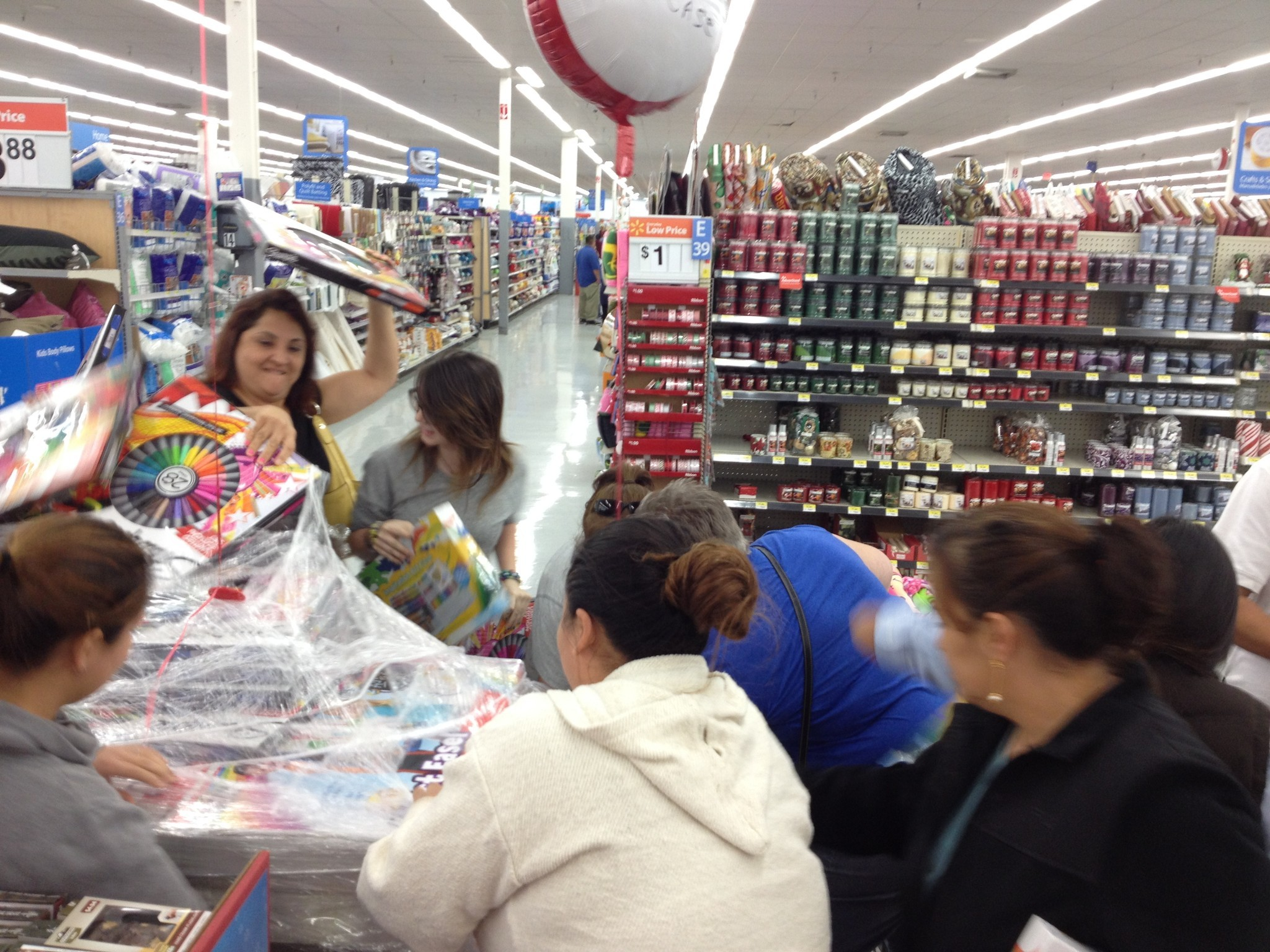 Shoppers at a Wal-Mart in Duarte on Thanksgiving scramble for Crayola crayon sets marked down to $11 from nearly $20.