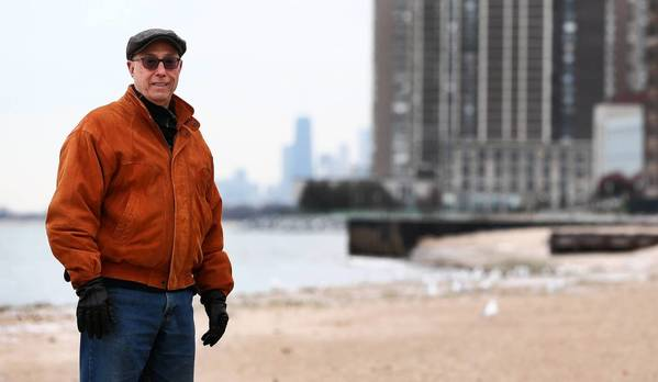 "Fred Schein, son of Rogers Park activist Tobey Prinz, stands at Pratt Beach Park. ""This beach would not exist if not for her,"" he said."