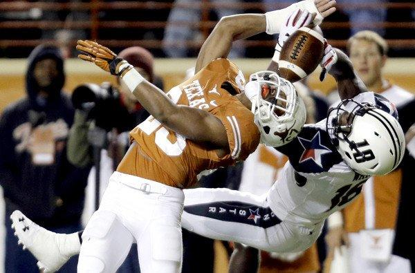 Texas defensive back Carrington Byndom deflects a pass intended for Texas Tech receiver Eric Ward (18) during the first half of their game Thursday night.