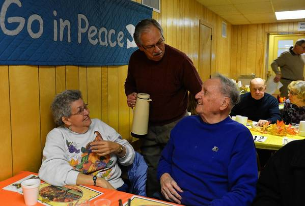 Don Dengler of Slatington serves up some coffee and conversation to Dolly Longenbach of Ballietsville and her friend, Russell Scheirer of Schnecksville, during a Thanksgiving dinner at St. John's United Church of Christ in Slatington. 'I'm glad we came,' Longenbach said.