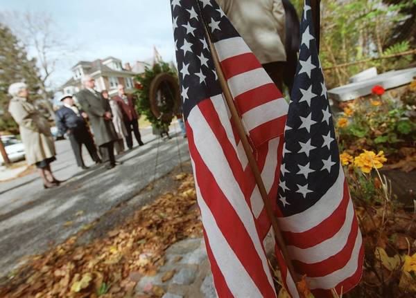 A small crowd gathers on Veterans Day in 2000 at the memorial for Revolutionary War soldiers whose remains were buried on First Avenue, Bethlehem.