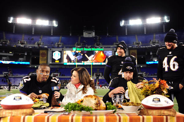 Baltimore Ravens kicker Justin Tucker (9) and wide receiver Jacoby Jones (12) are interviewed by NBC sideline reporter Michele Tafoya (center) after beating the Pittsburgh Steelers 22-20 Thanksgiving night at M&T Bank Stadium.