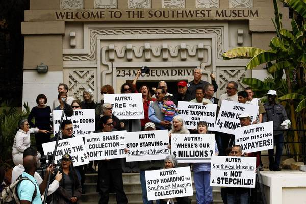 Supporters of the Southwest Museum rally to protest its treatment by the Autry National Center.