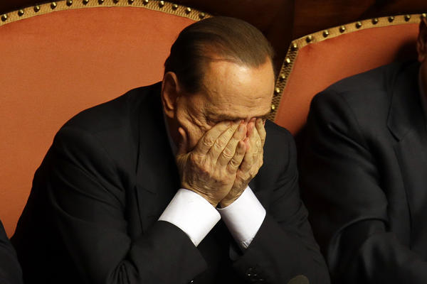 Silvio Berlusconi rubs his eyes after delivering a speech before the Italian Senate in Rome.