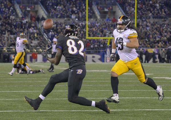 Pittsburgh Steelers safety Troy Polamalu closes in as Baltimore Ravens receiver Torrey Smith awaits a pass in Thursday's NFL game in Baltimore.