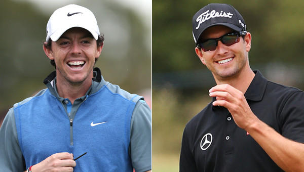 Adam Scott, right, leads Rory McIlroy by two strokes following the second round of the Australian Open.