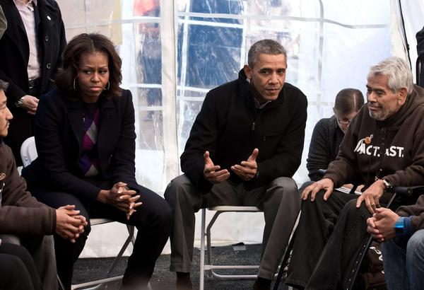 President Obama and First Lady Michelle Obama speak to people taking part in a Capitol Hill hunger strike on behalf of immigration reform. On the right is Eliseo Medina, who along with two others has not eaten in 18 days.