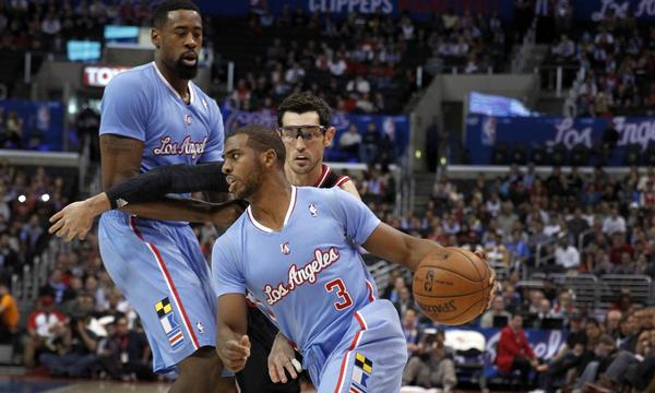Clippers point guard Chris Paul drives to the basket during Sunday's win over the Chicago Bulls. Paul injured his right hamstring against the New York Knicks on Wednesday.