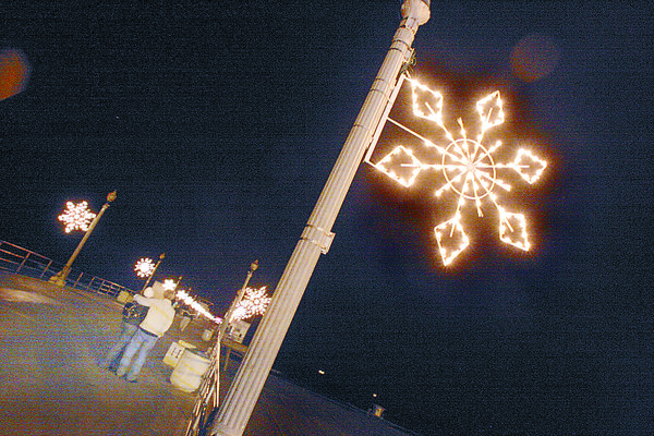 As part of the annual Light a Light of Love fundraiser in downtown Huntington Beach, metal snowflakes with LED bulbs are lit and remain that way until the first week of January.