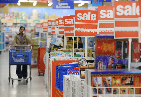 A shopper looks for bargains at the Toys R Us store in Glen Burnie on Black Friday.