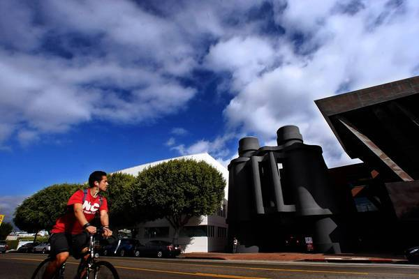 As more techies move into the Westside, there are fears that the area -- and especially the eclectic, funky vibe in Venice -- could go from charmingly quirky to overly techie. Above, a bicyclist rides past Google's offices on Main Street in Venice.