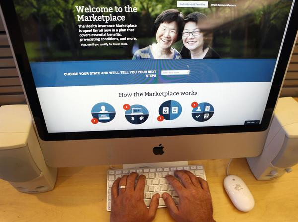 A man looks over the Affordable Care Act signup page on the HealthCare.gov website on October 2, 2013.