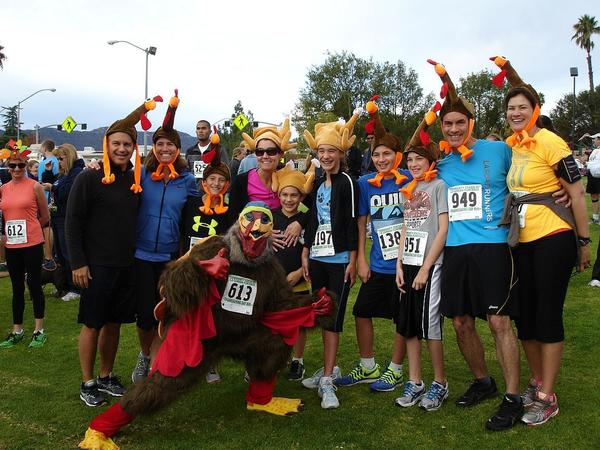 Some of the 1400 participants in the 20th annual Thanksgiving Day run sponsored by the Community Center turned out in costume.