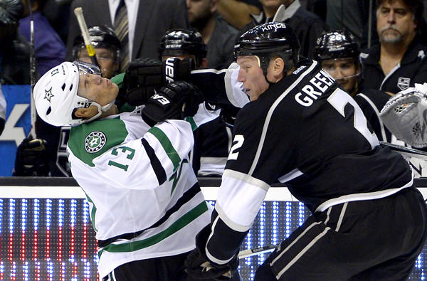 Kings defenseman Matt Greene sends Stars left wing Ray Whitney reeling during the third period of a game last month at Staples Center.
