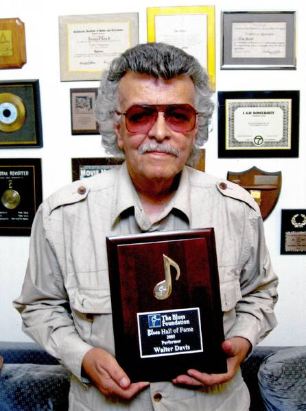 Tom Reed, also known as the Master Blaster, holds a plaque presented to Walter Davis, a Blues Hall of Fame inductee, in this undated photo.
