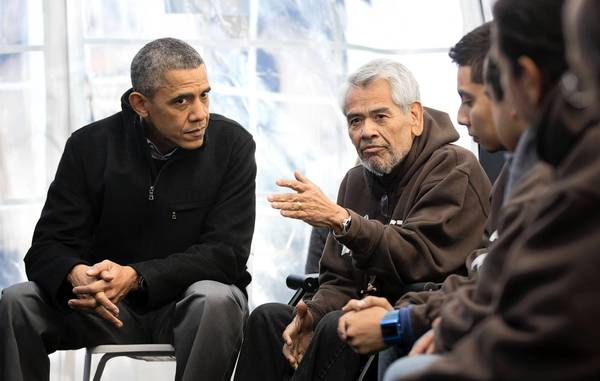 President Obama meets with labor leader Eliseo Medina, center, and others who are staging a hunger strike in a tent near the Capitol to protest the lack of progress on an immigration overhaul.