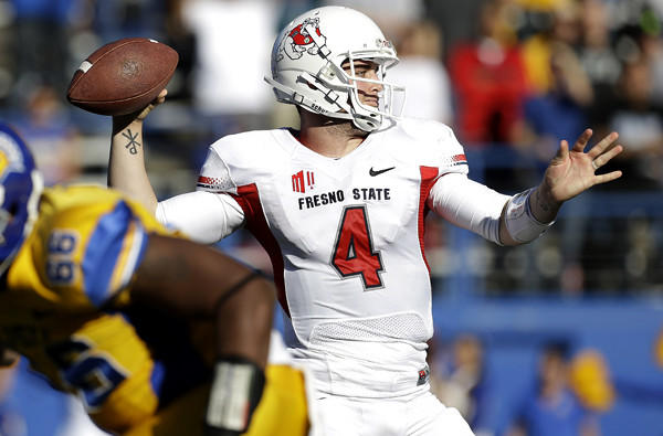 Fresno State quarterback Derek Carr (4) throws for one of his six touchdown passes in a loss to San Jose State on Friday afternoon.