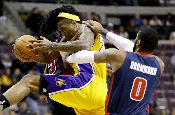 Lakers power forward Jordan Hill is fouled by Pistons center Andre Drummond on an inbounds play in the first quarter Friday evening in Detroit.