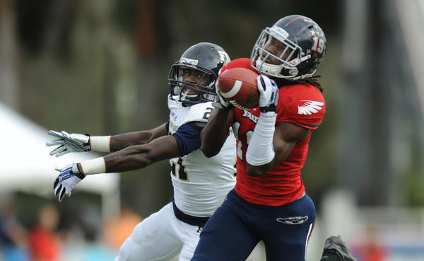 William Dukes of FAU catches a 59-yard touchdown pass over Randy Harvey of FIU in the first quarter. Florida International University vs. Florida Atlantic University. FAU Stadium, Boca Raton, FL. 11/29/13. Jim Rassol, Sun Sentinel.