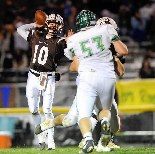 Catasauqua's Zack Bradley (left) looks for an open receiver against Pen Argyl High School on November 8, 2013.