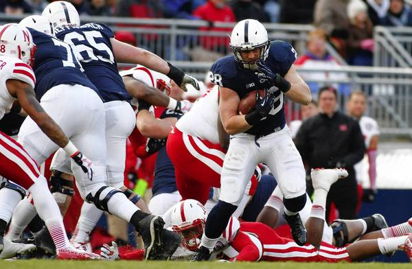 Zach Zwinak #28 of the Penn State Nittany Lions rushes against the Nebraska Cornhuskers during the game on November 23, 2013 at Beaver Stadium in State College, Pennsylvania.