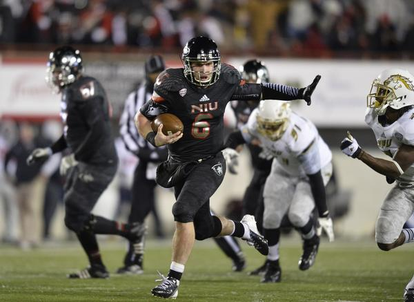 Huskies quarterback Jordan Lynch runs 37 yards for a touchdown during the third quarter against Western Michigan.