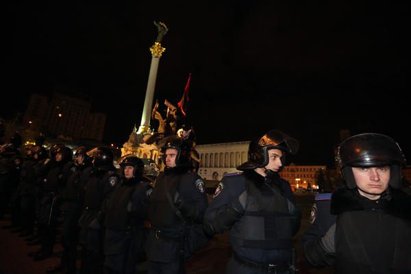 Police surround Independence Square in downtown Kiev, the Ukrainian capital, early Saturday. A monument to Ukraine's independence is in the background.