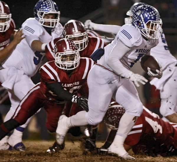 Burbank High School's #5 Joseph Pendleton runs the ball in game vs. Whittier's La Serna High School at California High in Whittier on Friday, Nov. 29, 2013. (Raul Roa/Staff Photographer)