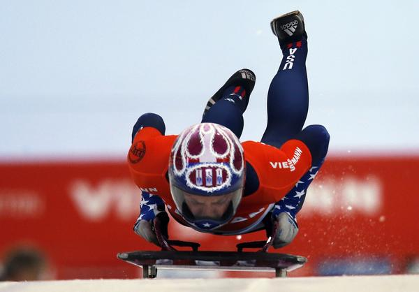 Noelle Pikus-Pace jumps on her sled during a run in the skeleton race at the World Cup event in Calgary, Canada, on Saturday.