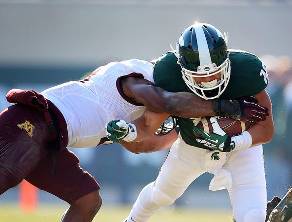 Michigan State Spartans running back R.J. Shelton is tackled by Minnesota Golden Gophers linebacker Damien Wilson.