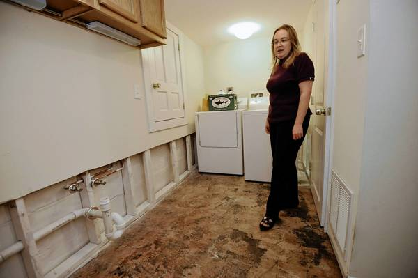 Brienne Daugherty's basement was flooded after a BGE contractor damaged her sewer line while replacing gas infrastructure beneath the sidewalk in front of her house. The backup started in the laundry room soaking the carpet and walls. Mold remediation took out two feet of the wall. She's frustrated that the company's insurer isn't willing to pay what repair contractors say the job will cost.